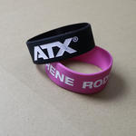 "Extra wide ailicone wristbands (25mm  / 1"" wide) with custom artwork image"